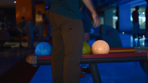 legshot - bowling balls at neon bowling Footage