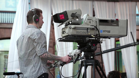 Videotape operator with big camera at work Footage