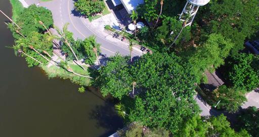 aerial birds eye drone selfie scooter at University lake Footage