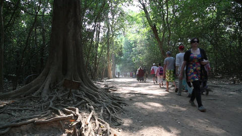 People in the area of Angkor Thom temple complex in Cambodia Footage