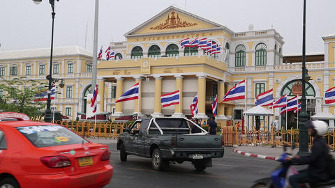 Road traffic close by the Thailand Ministry of defence in Bangkok Live Action