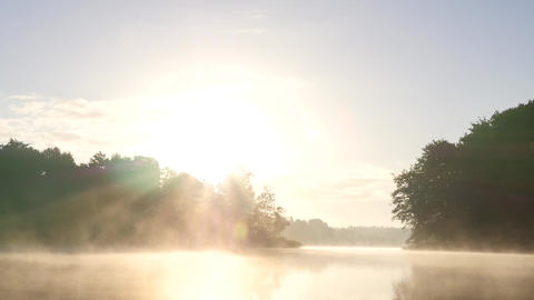 Sunrise over a foggy lake in fall Footage
