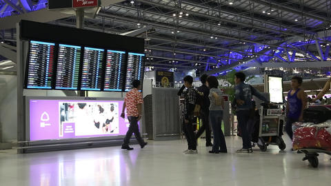 People near information board in Bangkok international airport, Thailand Footage