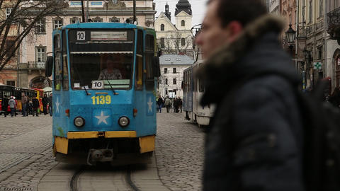 Blue trams and people on the Market Square in Lviv, Western Ukraine Footage