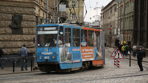 Blue tramway near the Dormition or Assumption church in Lviv, Western Ukraine Footage