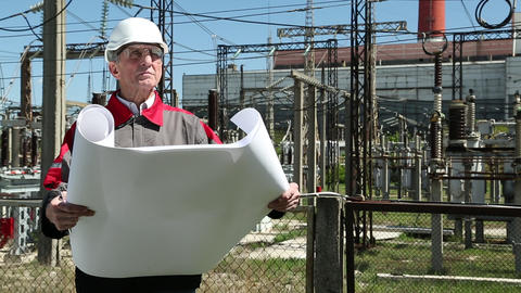 Station technical director with working drawings at nuclear power station Footage