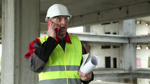 Civil engineer with cell phone at construction site Footage