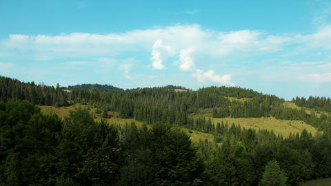 4K Timelapse of clouds and beautiful green mountains with coniferous trees Footage
