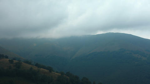 4K Timelapse of storm clouds in mountains Footage