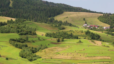 Beautiful green and yellow hills and houses with red roofs Footage