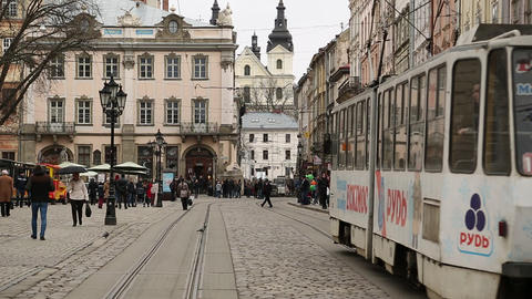 White tram and people on the Market Square in Lviv, Western Ukraine Footage