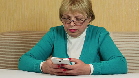 Woman typing sms on her cell phone. Woman with white smartphone Footage