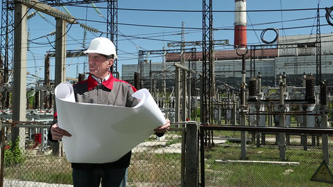 Chief Architect With Working Drawings At Heat Station stock footage