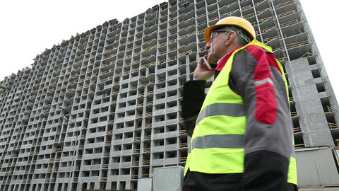 Resident engineer with mobile phone on the construction site Footage
