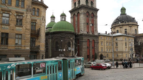 Road traffic near the Dormition or Assumption church in Lviv, Western Ukraine Footage
