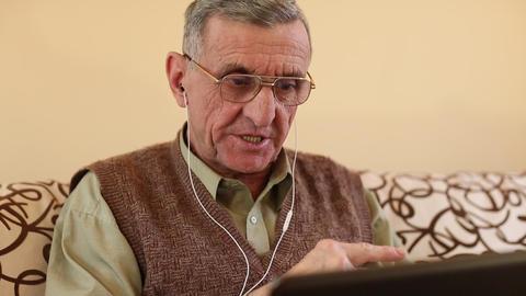 Senior man communicates via laptop. Man with notebook Footage