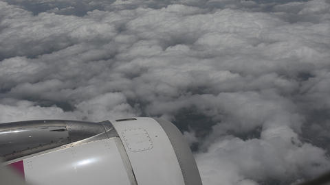 View From Windows An Airplane On The Sky Pass Clouds stock footage