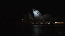 sydney opera house with projected woman Footage