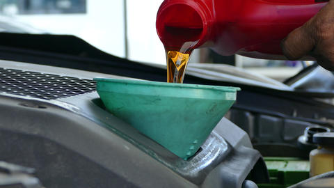 motor oil being poured into a funnel Footage