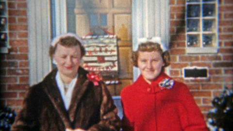 1957: Family leaving house for church Christmas mourning Footage