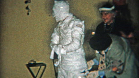 1956: Mummy halloween costume and other old timey costumes Footage