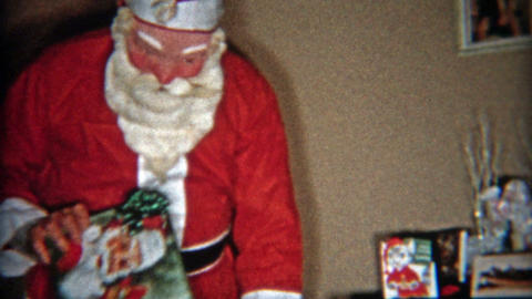 1953: Lazy Santa Claus gets up and gives more presents Footage