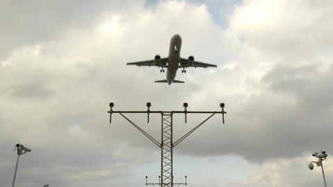 Airport Landing Lights And A Airplane Landing In 4K UHD stock footage