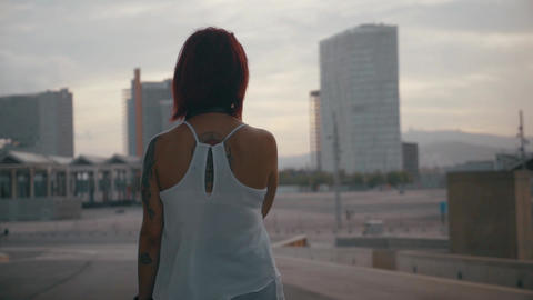 Woman looking at the city and buildings in slow motion Footage