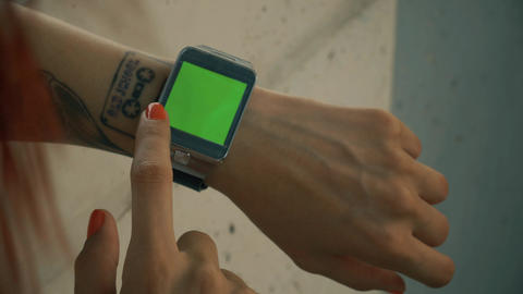 Woman using his green screened smart watch Footage