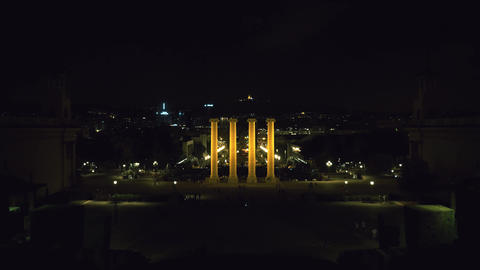 Plaza Espana in Barcelona at night with the four columns Footage