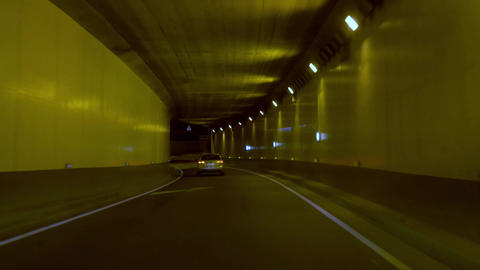 Car accessing the high way trough a tunnel at night Footage