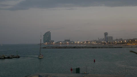 Boat entering Port Olimpic Marina in Barcelona Footage