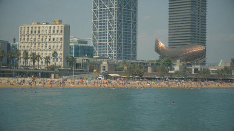 detail of Barceloneta beach and Barcelona sky line from the sea Footage