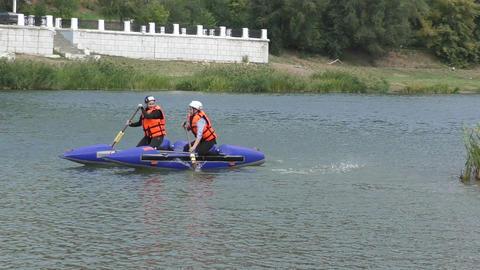 Girls Learn To Rafting On A Catamaran stock footage