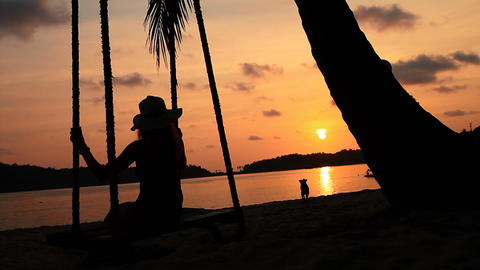 girl on the beach and evening sunset Stock Video Footage