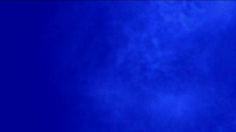 Smoky Clouds in blue background Stock Video Footage