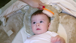 Mother Combs Baby Stock Video Footage