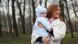 Baby and Mother in Park Stock Video Footage