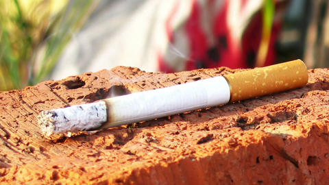 Smoking cigarette dolly shot time lapse fly around Stock Video Footage