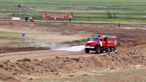 Firetruck on rally cross track in russian province Stock Video Footage