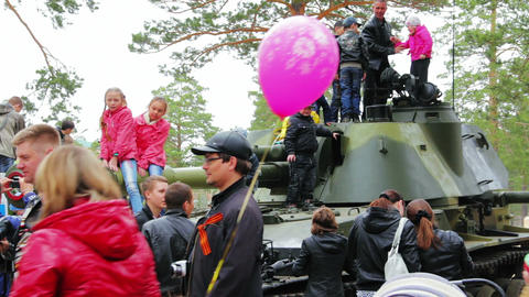 Civilian people look at military vehicles and panz Stock Video Footage