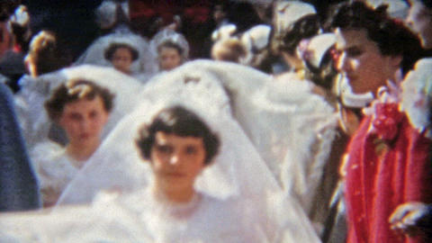 1955: Girls first communion with mother, classmates, brother and neighbors Footage