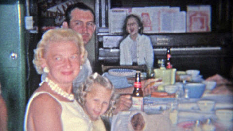 1955: Family drinking Budweiser Beer at the kitchen table during thanksgiving ho Footage