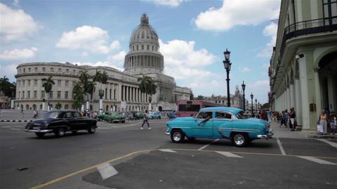 Blue Old Cuban Car Crosses The Street Near The Capitol Of La Havana Cuba stock footage