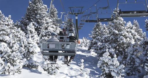 Ski lift in the trees in 4K cinema Footage