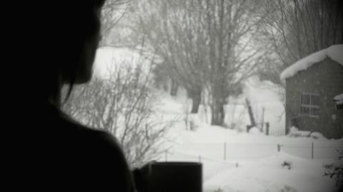 Girl at window while snowing Footage