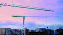 Bucharest, Romania - October 2015 Cranes Working For A New Mall At Dusk, Pan stock footage