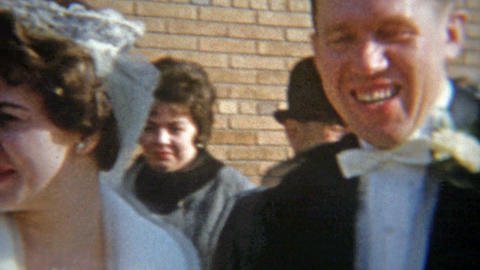 1964: Just married rice thrown at couples head as they escape Footage