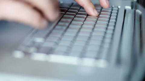 Man's hands typing on laptop keyboard Footage