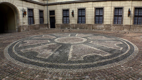 Mosaic in the old stone courtyard. 4K Footage